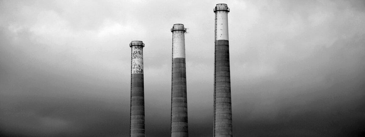 Three tall large power station towers black and white image