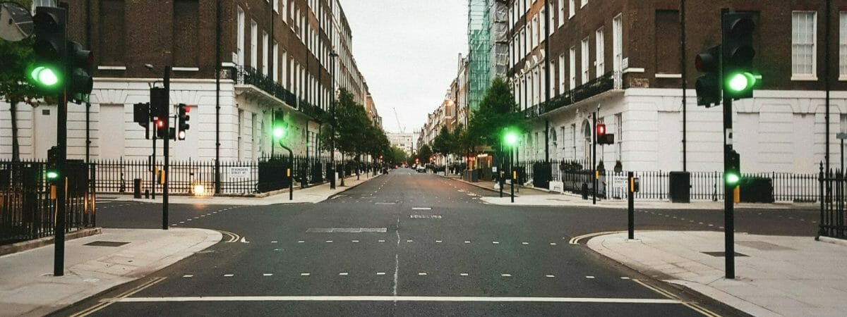 Intersection of two road, green traffic lights - no cars